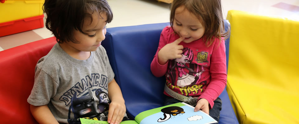 Children reading Say It First books